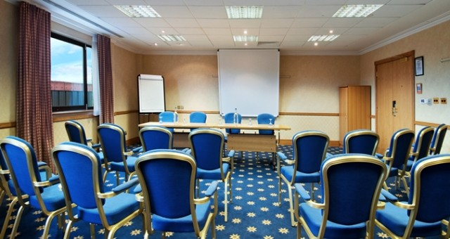 Training Room set up in theatre style with chairs facing a projector screen Hilton Swindon Venue Hire SN5