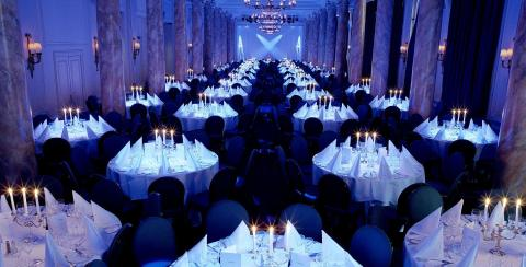 Waldorf Hilton Christmas Party WC2, seated dinner, stunning lighting and collumns, large capacity