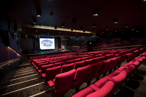 Museum of London Venue Hire EC2Y. Theartre set up for a conference, theatre style with screen infront.