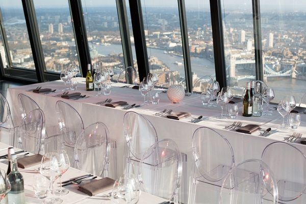Leadenhall Landing Forty Two Summer party EC3 . Tables and chairs set up for guests to dine and look at views of London in this iconic building