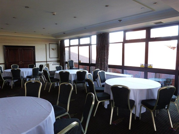National Conference Centre Venue Hire B92. Tablles set up for an conference with daylight