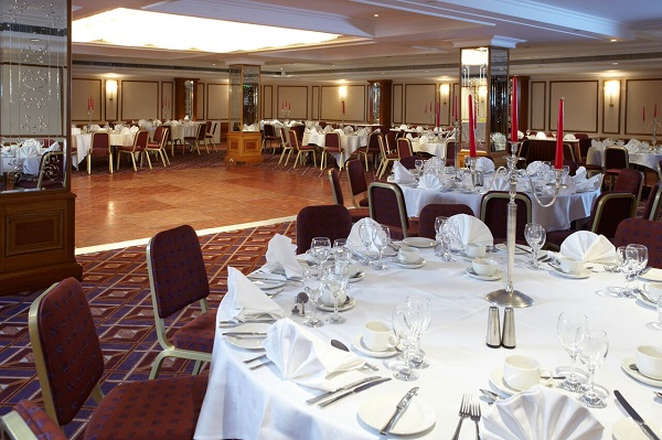 National Conference Centre Venue Hire B92. Tabkes set up banqueting style with large space in the centre of event space