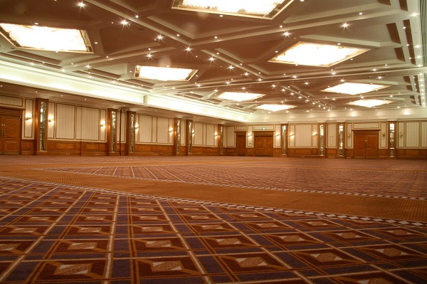 National Conference Centre Venue Hire B92. Large event space with carpet and ceiling with large lights. this space can used for a conference or dinner dance.