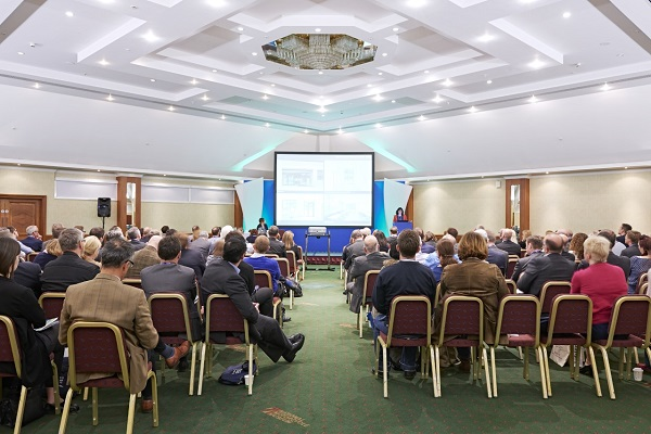 National Conference Centre Venue Hire B92. Conference being held with theatre styled chairs and screen for presentation
