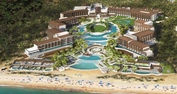 Large swimming pool with resort around it on the beach.. Dreams Playa Mujeres Golf Spa Resort C.P.77400