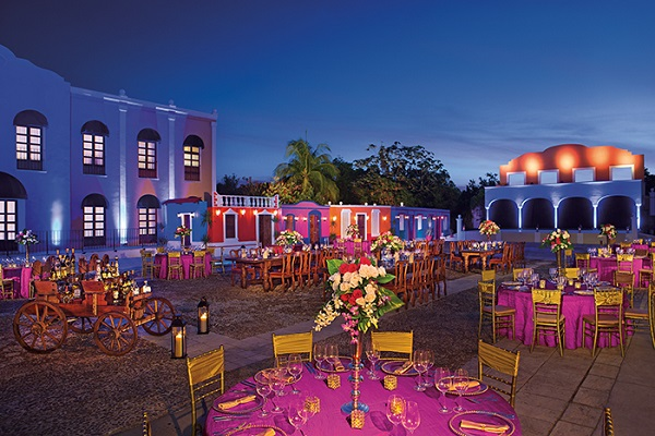 Dreams Tulum Resort & Spa 77780. Outside area of resort, colourful tables and chairs set up