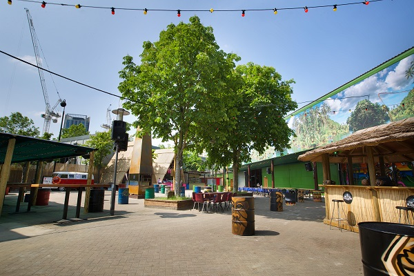 Hawker House Summer Party SE1. Outside space with fairy lights and tree with containers.