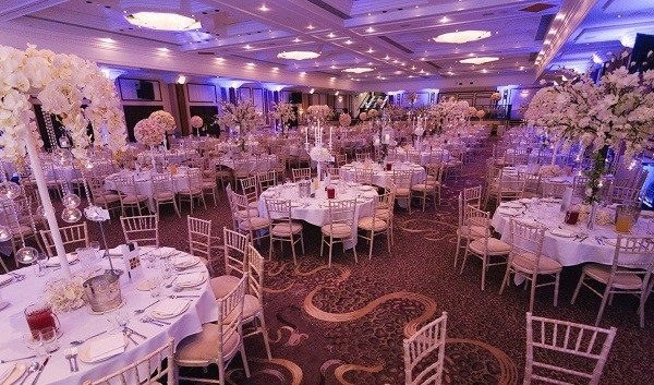 National Conference Centre Christmas Party B92. lovely banqueting round tables with delicate chairs for guest to be seated to enjoy their Christmas dinner