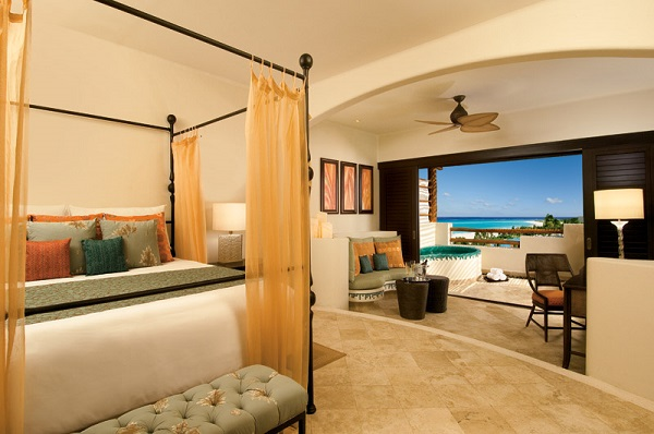 Secrets Maroma Beach 77710 Junior suite with a four poster bed and ocean view