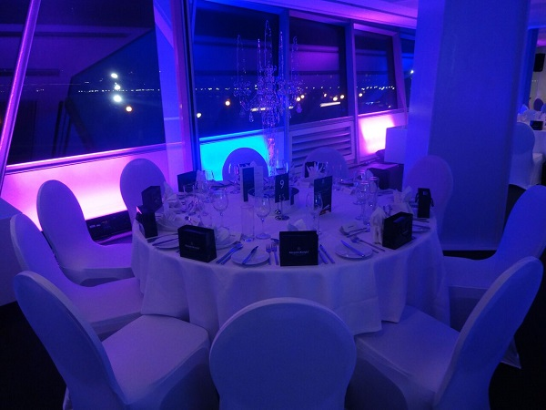 Crystal Christmas Party E16. Festive lighting with tables set out banqueting style.