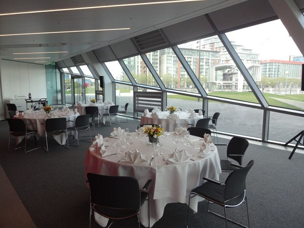 Crystal Christmas Party E16. Festive lunch with large windows and tables set up banqueting style.