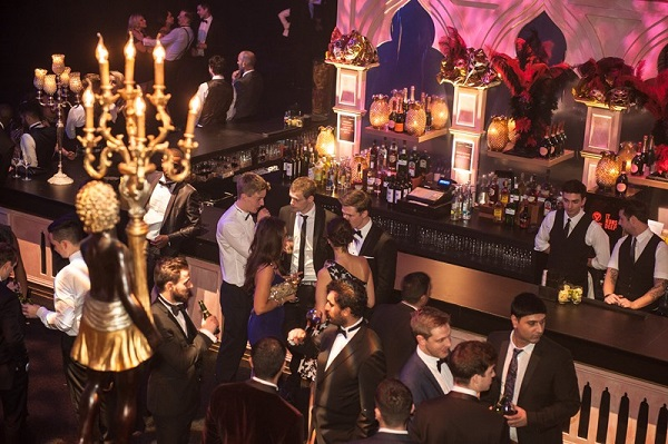Masquerade Ball Christmas Party Manchester M41. Birds eye view of guests standing at bar enjoying their evening.