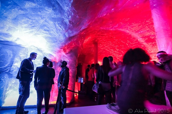 Grotto Outré Fire Cave Christmas Party E2. pop up cave with festive lighting while guests stand and enjoy being entertained