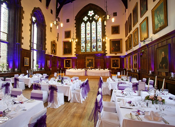 Durham Castle Venue Hire DH1. great Hall with furnishings of banqueting tables and chairs