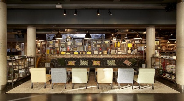 Hoxton Grill Christmas party EC2A. Lounge of venue with chairs tucked in table