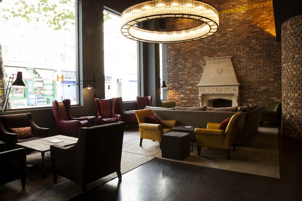 Hoxton Grill Christmas party EC2A. Fireplace on exposed brickwork and furnishings surrounding it