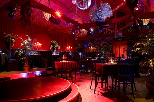Proud Camden Venue Hire NW1. inside of venue with coloured lighting up event space