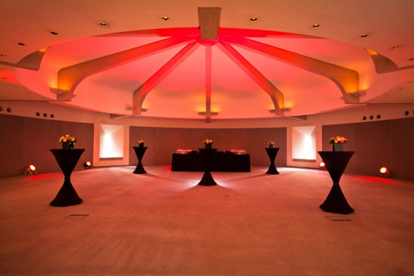 Royal College of Physicians Christmas Party NW1. Standing reception area with light in ceiling of venue.
