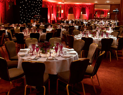 Radisson Blu Edwardian Heathrow Shared Christmas party UB3- dining room set out banqueting style for a Christmas meal