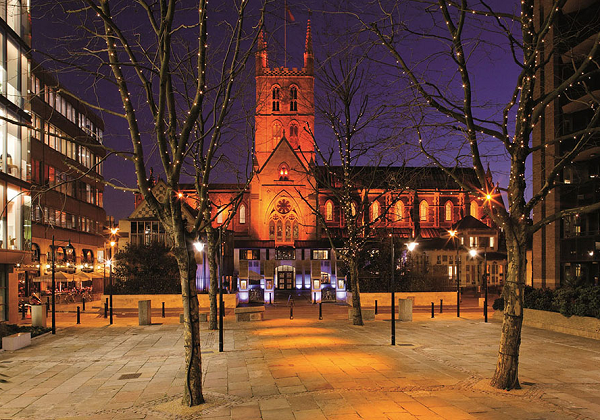 Southawk Cathedral Venue Hire SE1. festive image of exterior of building with fairy lights