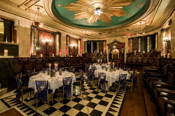 Andaz Liverpool Street Christmas Party EC2M. In the historic temple of The Andaz. Tables and chairs set up banqueting style.