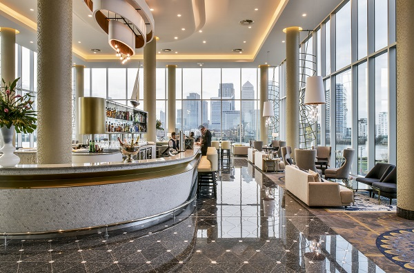 InterContinental London O2 Christmas Party SE10 Large open space with high windows and bar in middle