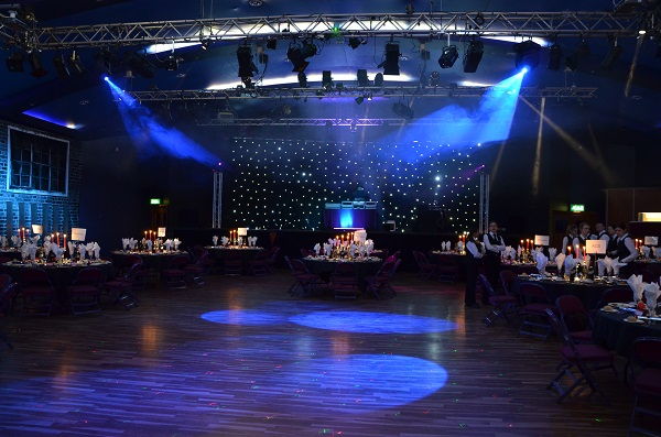 H.G. Wells Conference & Event Centre GU21 Large hall with Christmas theming and dance floor in middle with tables and chairs on the outside of room