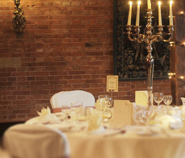 Coombe Abbey Christmas Party CV3 table set out with festive candles and furnishings