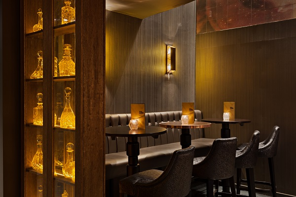 Dirty Martini Minories Venue Hire EC3N furnishings, tables and chairs with candles burning