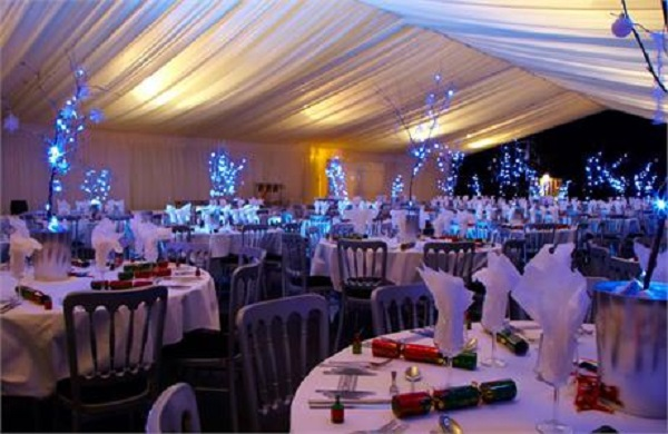 Swansea Village Hotel Christmas Party SA1- Christmas dinner party set out banqueting style with festive centre pieces