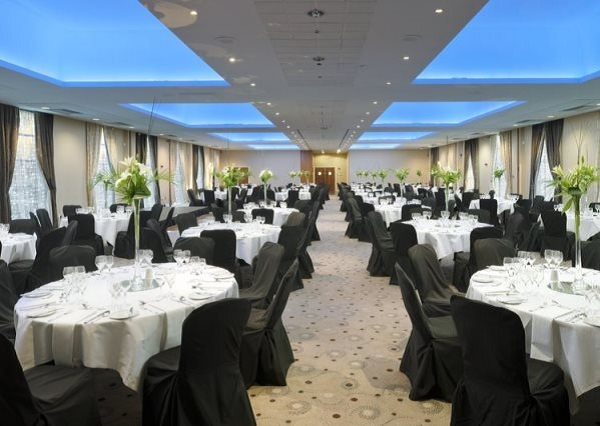Crowne Plaza Liverpool Shared Christmas Party L3 Round tables banqueting style in large room for clients to enjoy their shared Christmas party night