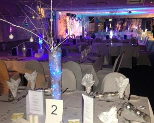 Everton Football Club Christmas Party L4 banqueting tables set out with christmas decorations on each table