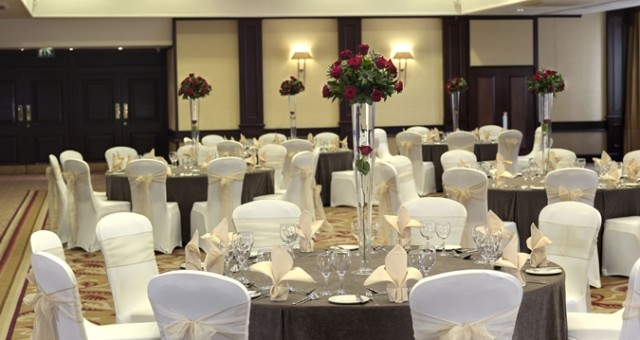 Hilton Glasgow Grosvenor Shared Christmas Party G12 round tables and chairs set out for a Christmas party