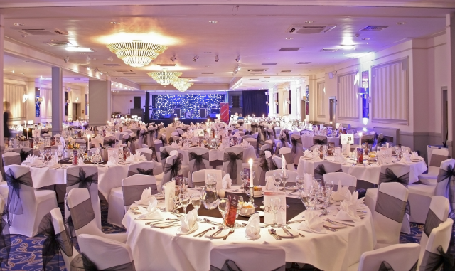 Hilton Aberdeen Treetops Shared Christmas Party AB1 in large room with tables and chairs set out for christmas event