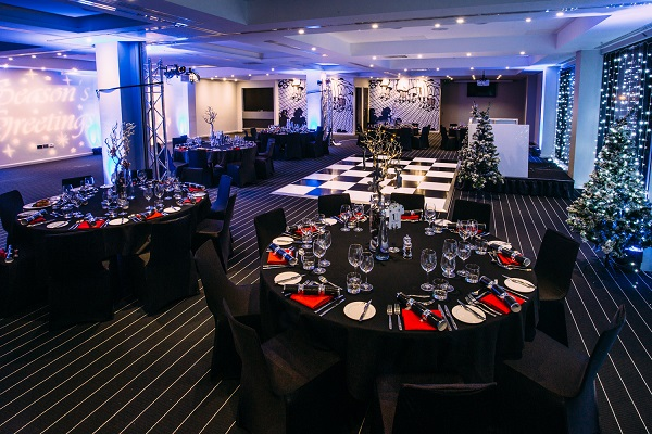 Hotel Football Old Trafford Christmas Party M16 banqueting tables set out with themed decorations
