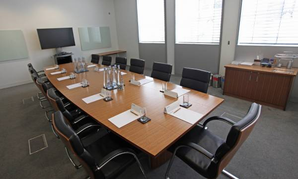 Nottingham Conference Venue Hire NG1- Board room with notepads and refreshements for 12 people