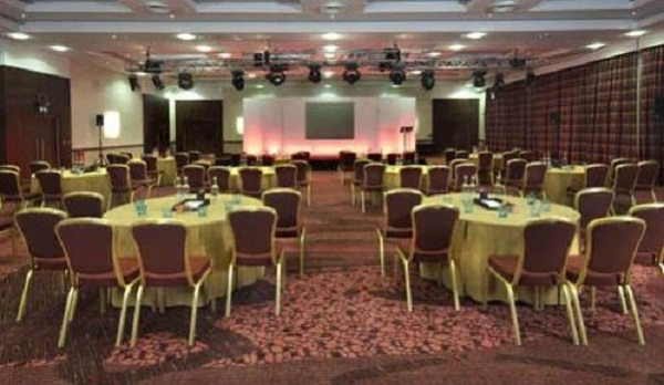 Ashford International Hotel Venue Hire TN24- Conference set out caberet style with notepads and flipchart