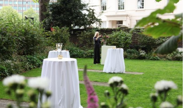 45 Millbank Summer Party Venue SW1- Gardens set out with poser tables for summer party drinks