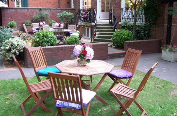 Imperial College London Summer Party SW7- Garden area set out for summer party drinks
