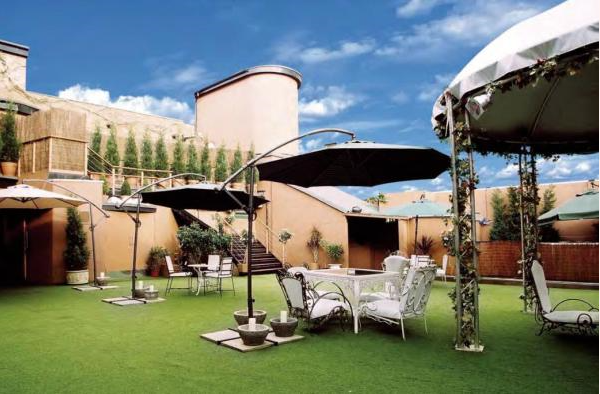 Egg Summer Party Venue N7 Outdoor roof terrace set out for summer party drinks