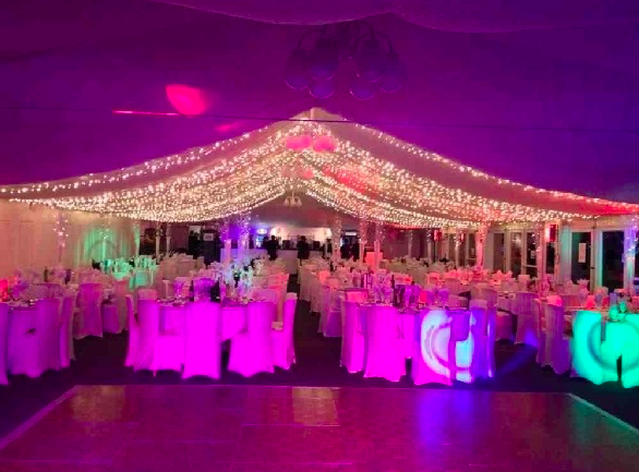Hamilton Park Racecourse Christmas Party ML3 A marquee at Hamilton Park Racecourse with a dancefloor and round tables decorated for Christmas