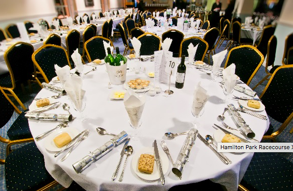 Hamilton Park Racecourse Christmas Party ML3 A close up of a round table with Christmas decorations