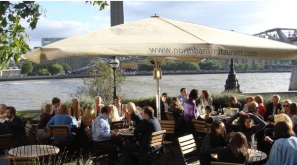 Northbank Restaurant & Bar Summer Party EC4- Summer party guests enjoying their riverside drinks